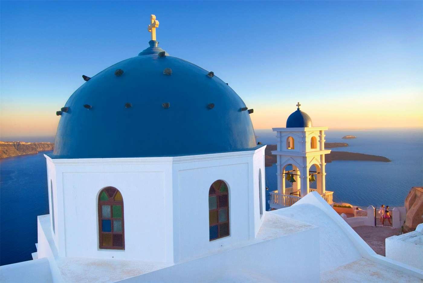 Tourism photographer JP Bond captures a beautiful church reflecting the sunset on Santorini, Gr