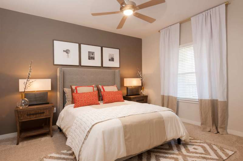Architectural interior photography for Huntsville apartment complex showing a gorgeous bedroom.