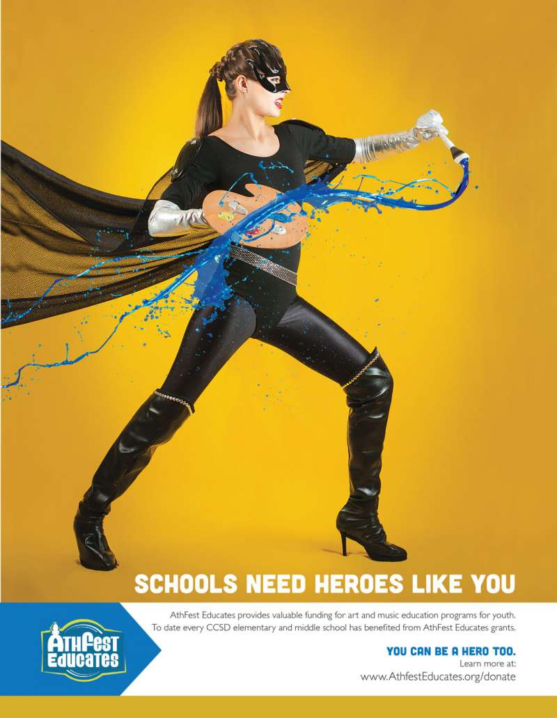 Advertising photograph showing a superhero woman slicing the air with a paint brush.
