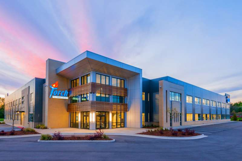 Commercial real estate photography of a modern corporate building with a sunset sky.