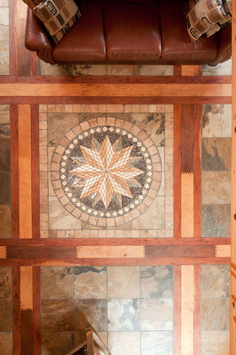 Architectural photography detail of a radial design inlay tile floor pattern.