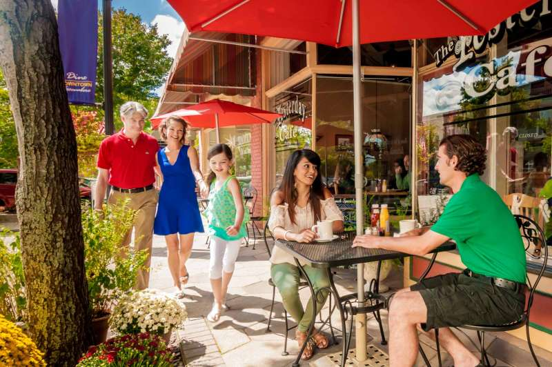 Tourism and hospitality photography featuring happy couples outside a downtown cafe.