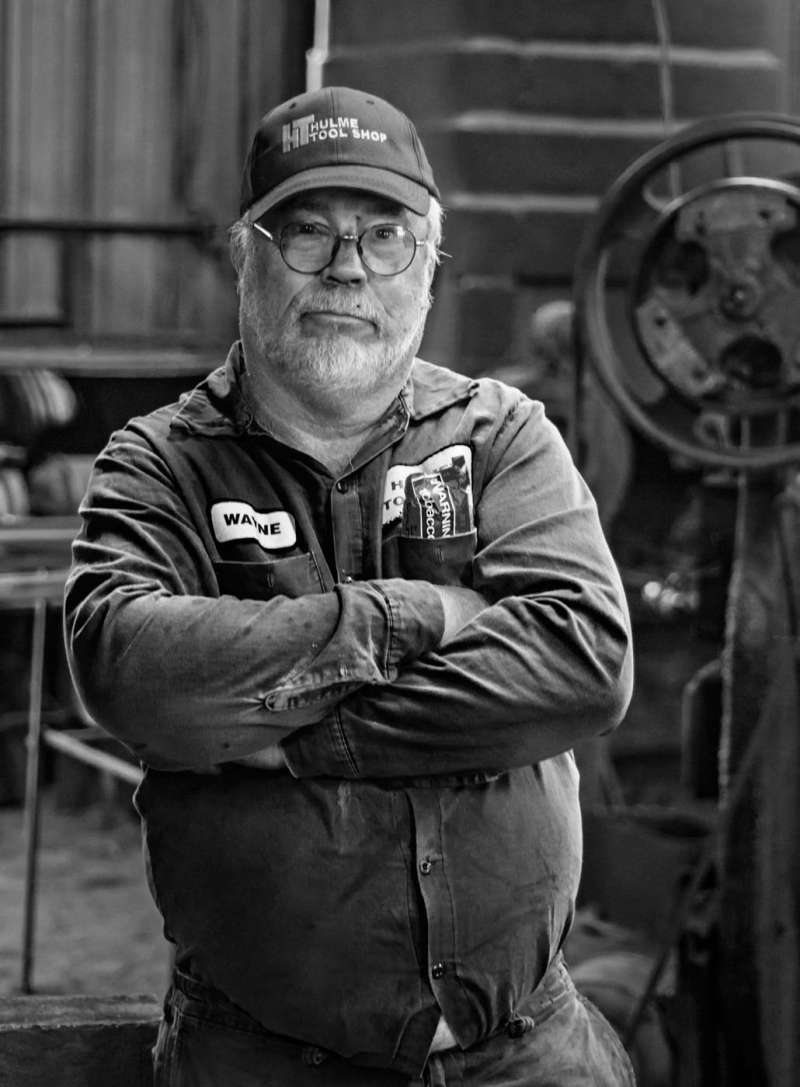 Editorial portrait of an industrial metal worker in black and white.