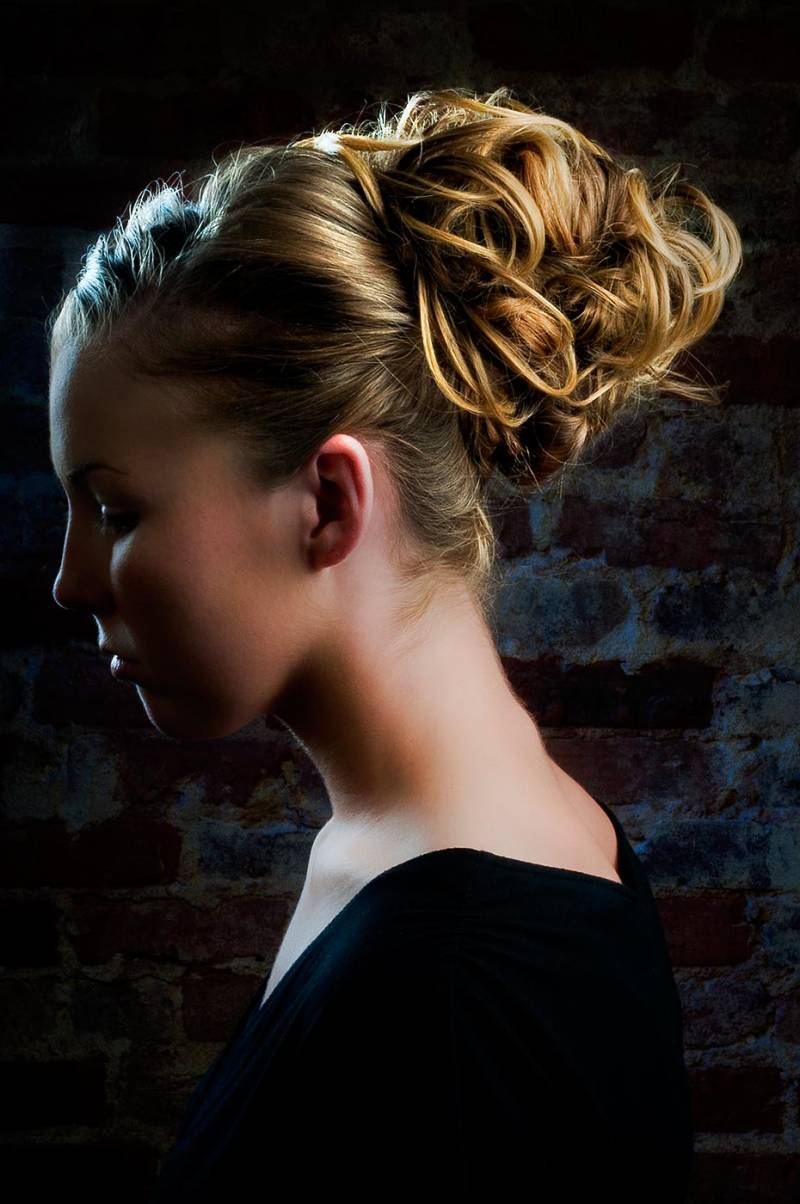 Fashion photography for a hair salon featuring a beautiful actress with a stylish hair design.