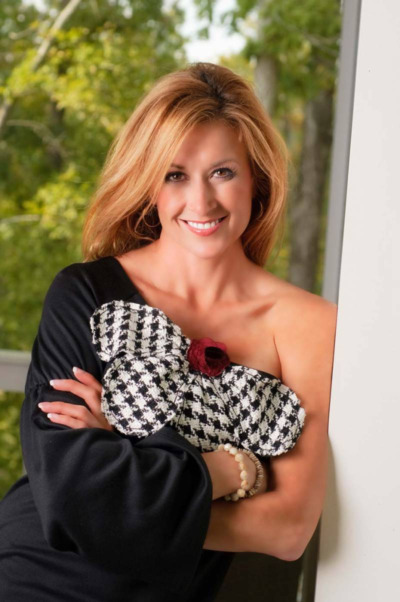 Lifestyle portrait featuring a fashionable woman in designer apparel.