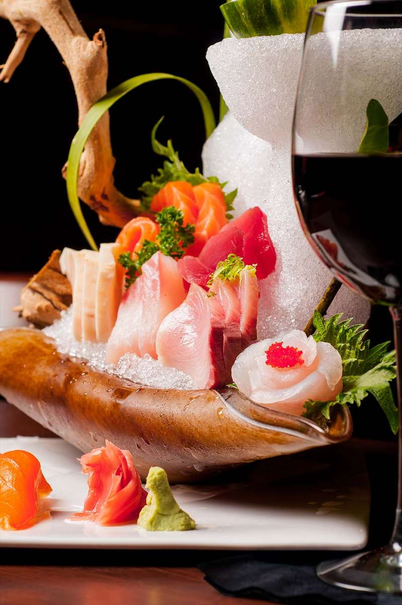 Advertising food photography for a restaurant showing sushi artfully plated.