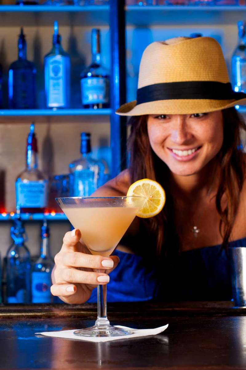 Restaurant photography showing a frosty martini in bartender's hands.