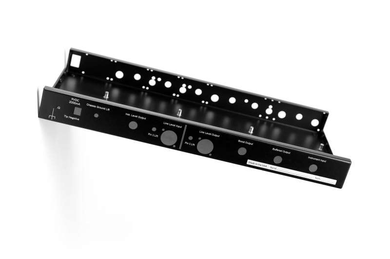 Photo of an amplifier controls frame without internal components on a white background. Photo has been rotated to add a sense of movement.